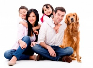responsible owner - a family dog with its owners