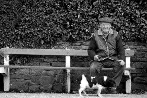 Dog and elderly man