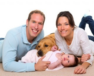 Family with new born baby and dog