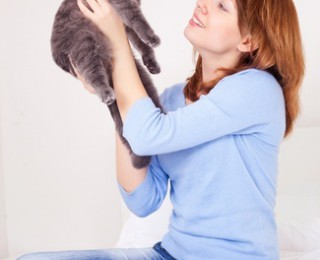 Young woman and cat