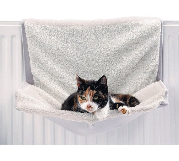 Tabby cat relaxes in a cosy white Radiator cat bed valentine's gift ideas